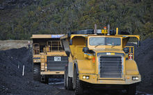 Huge trucks move high-grade coal from a stockpile at the Stockton Mine near Westport.
