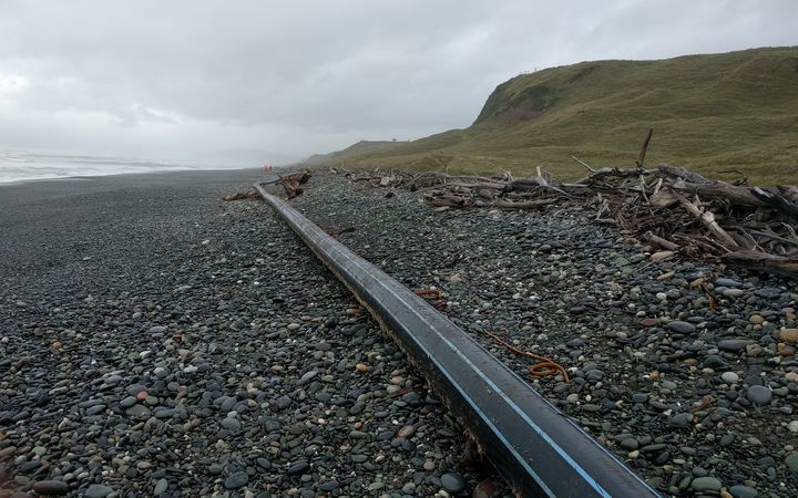 The 100m-long pipe that washed up on the Southland beach.