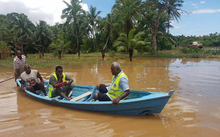 A Fiji Red Cross team assesses Waivou village, Fiji after a week of flooding in December 2016.