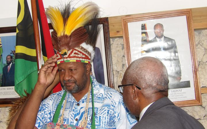 Vanuatu prime minister Charlot Salwai accepts traditional head dress from the United Liberation Movement for West Papua.