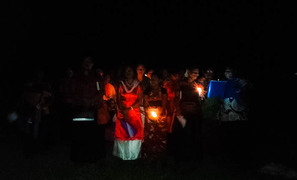 Villagers from Muana, Toga island, in Fiji's Rewa River delta, sing Christmas carols surrounded by floodwaters, December 2016