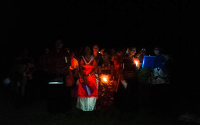 Villagers from Muana, Toga island, in Fiji's Rewa River delta, sing Christmas carols surrounded by floodwaters, December 2016.
