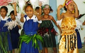 Students at a mission school in Samoa dancing.