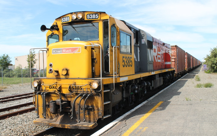 A northbound freight train at the Rangiora Station.