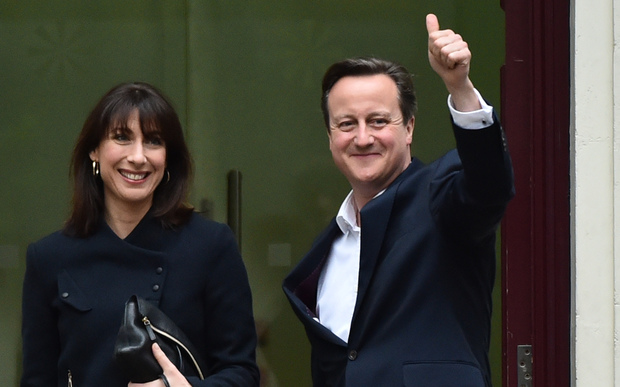 British Prime Minister and Leader of the Conservative Party David Cameron (R) and his wife Samantha.
