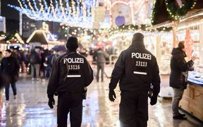 Police patrols at the reopened Christmas market near the Kaiser Wilhelm Memorial Church in Berlin.