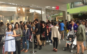 Long queues of shoppers waited to get into clothing retailer H & M at Auckland's Sylvia Park Mall.