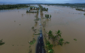 An aerial photo shows a flooded highway after typhoon Nock-Ten made landfall in Polangui, Albay province, in the Philippines.