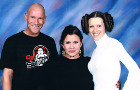 New Zealand Star Wars fans Matt ad Kristy Glasgow with Carrie Fisher in 2011.
