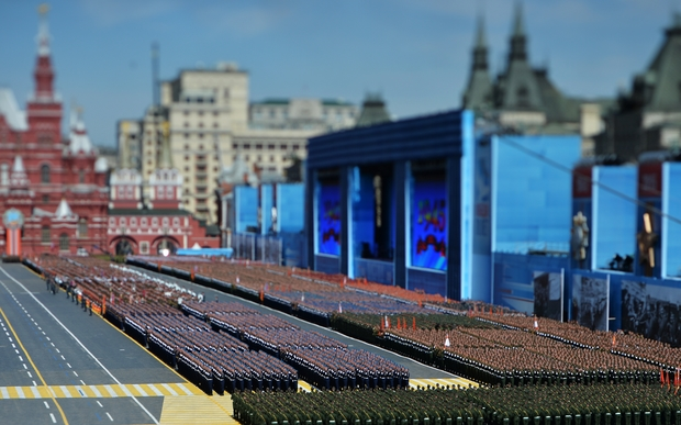 A photo taken with a tilt-shift lens shows soldiers marching through Red Square.