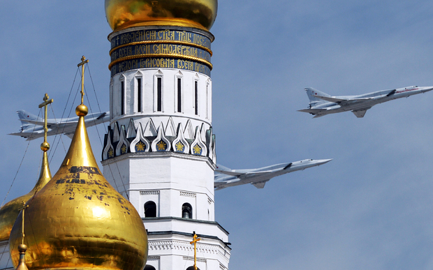 Tupolev Tu-22M3 Backfire strategic bombers fly over Red Square.