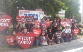 About 50 people are protesting outside the Warkwarth rodeo.