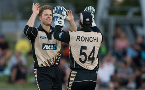 New Zealand's Lockie Ferguson and Luke Ronchi celebrate a wicket.
