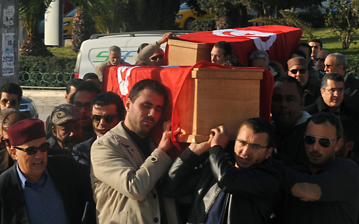 Relatives and friends carry the coffins of husband and wife Mohamed Azzabi and Senda Nakaa who were victims of the Istanbul nightclub shooting on New Year's Eve, during their funeral at a cemetary in La Marsa, near the capital Tunis, on January 3, 2017.