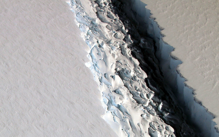 This NASA photo released December 1, 2016 shows what scientists on NASA's IceBridge mission photographed in a view of a massive rift in the Antarctic Peninsula's Larsen C ice shelf on November 10, 2016.
