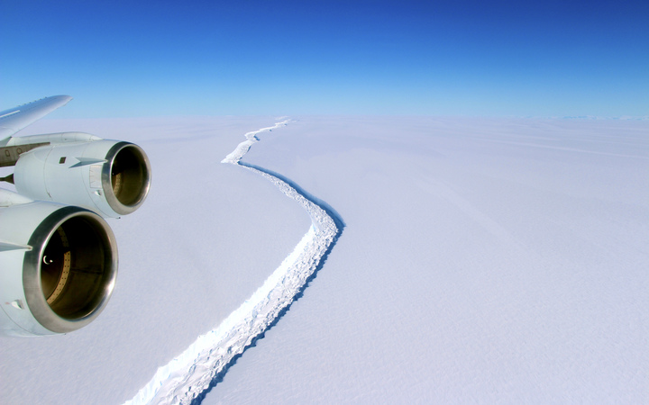 The crack in the ice-shelf can be seen stretching into the distance.