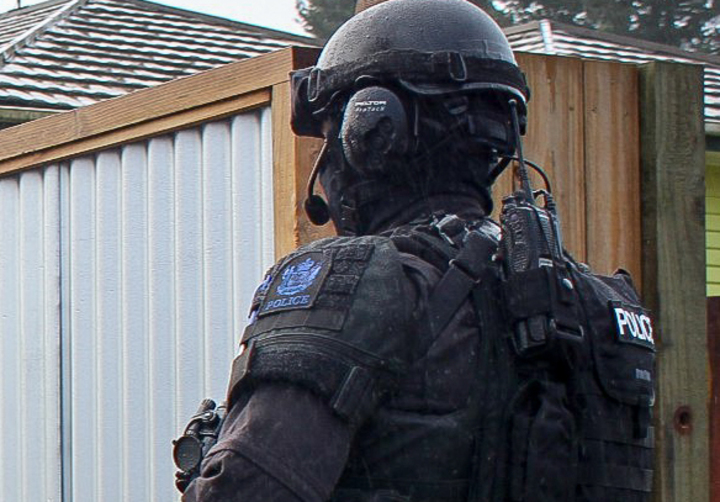 Armed police officers during an operation.