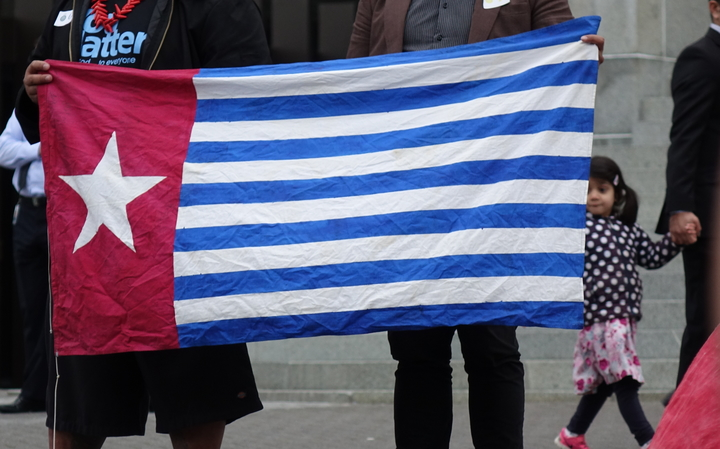 David Tua and Jerome Mika hold the West Papuan Morning Star flag outside New Zealand's parliament, 25 August, 2016.
