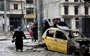 Syrian civilians from the al-Sukari neighbourhood flee on December 14 2016.