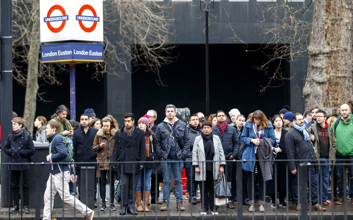 Commuters walk to work as London Underground services are severely disrupted due to members of RMT and TSSA unions start a 24-hour strike action in a dispute over jobs cuts and closed ticket offices on January 9, 2017.