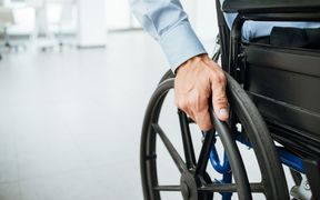 close-up of hand and wheelchair