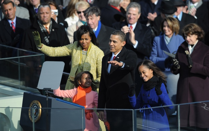US President Barack Obama waves with his family after being sworn in as 44th US president January 20, 2009 in Washington, DC.