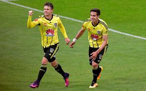 Phoenix's Michael McGlinchey (L) celebrates scoring a goal with team mate Alex Rodriguez.