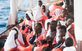 Migrants are rescued from a boat off the Libyan coast in December 2016. About 100 people are now missing after the boat they were on sank.