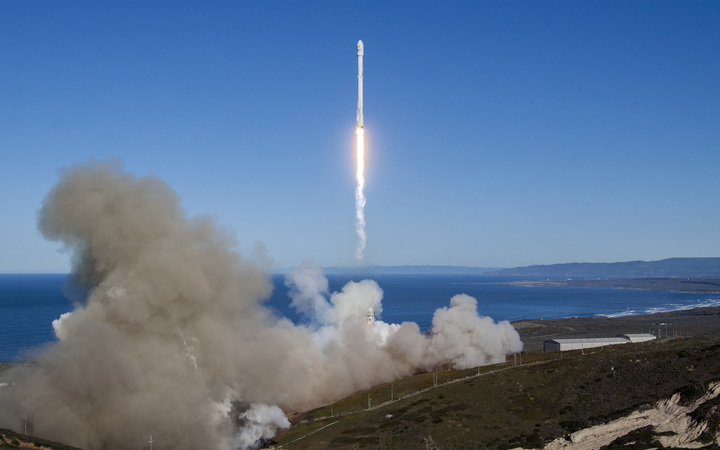 A Falcon 9 rocket lifting off from Vandenberg Air Force Base, California, on January 14, 2017