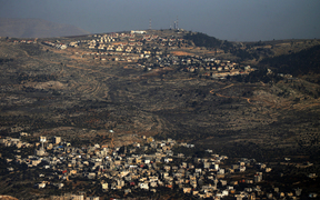 A picture, taken from Nablus, shows in the foreground the Palestinian West Bank village of Azmout and in the background the Jewish settlement of Elon Moreh