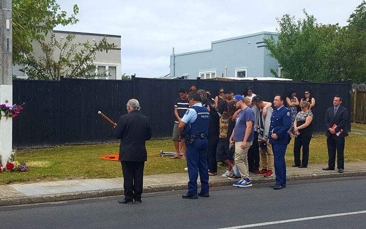 A blessing is held for Jacob Pakura at the scene where he was found fatally injured, on Rua Road in New Lynn.
