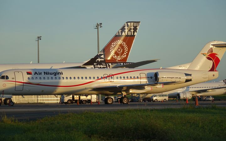 Air Niugini and Fiji Airways parked at Nadi International Airport in Fiji