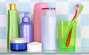 A collection of personal hygiene and body care products, including toothpaste, soap and body wash.