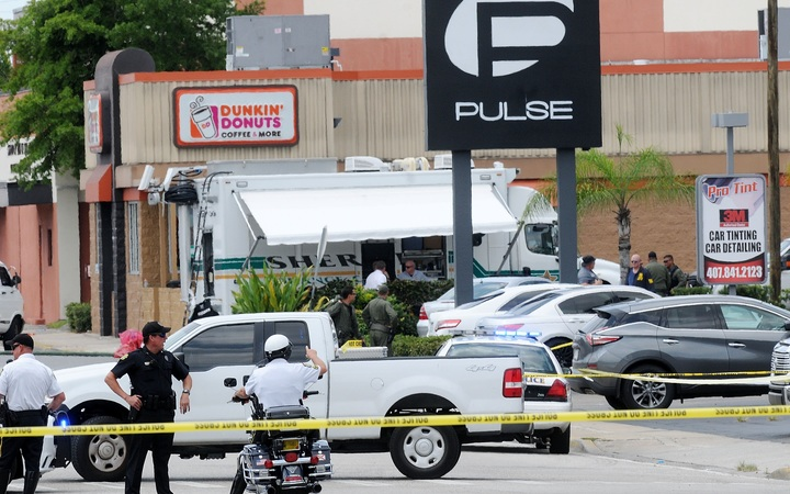 ORLANDO, FLORIDA - JUNE 12: Orlando police officers seen outside of Pulse nightclub after a fatal shooting and hostage situation on June 12, 2016 in Orlando, Florida. The suspected shooter, Omar Mateen, was shot and killed by police.