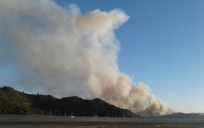 A photo taken about 7.50pm shows a fire burning near the town of Whitianga.