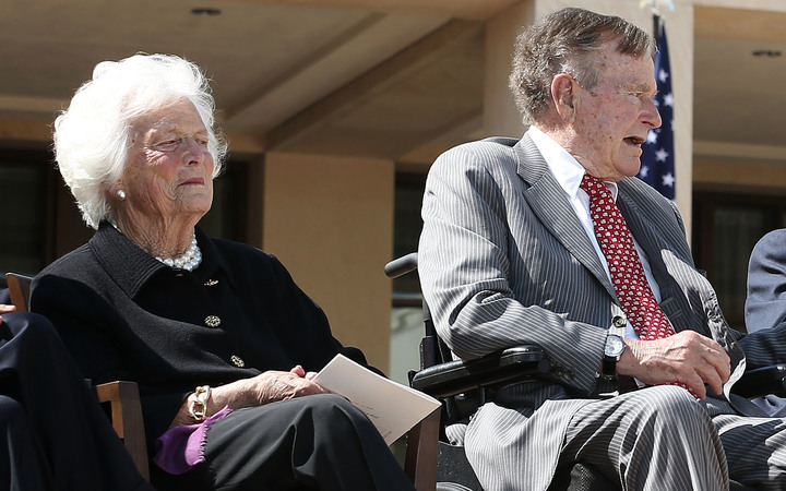 George H W Bush (centre) with wife Barbara and son George W Bush.