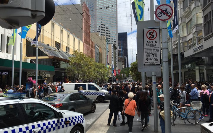 A car has hit pedestrians in the centre of Melbourne, killing at least one person, Australian emergency services say.