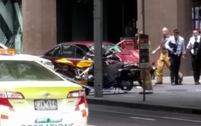 Police in Melbourne have arrested a man after a car hit pedestrians in the city centre, killing three people and injuring at least 20.