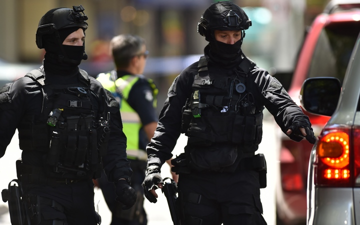 Australian SWAT police are seen on Bourke Street after a car ploughed into pedestrians in the centre of Melbourne on 20 January, 2017.