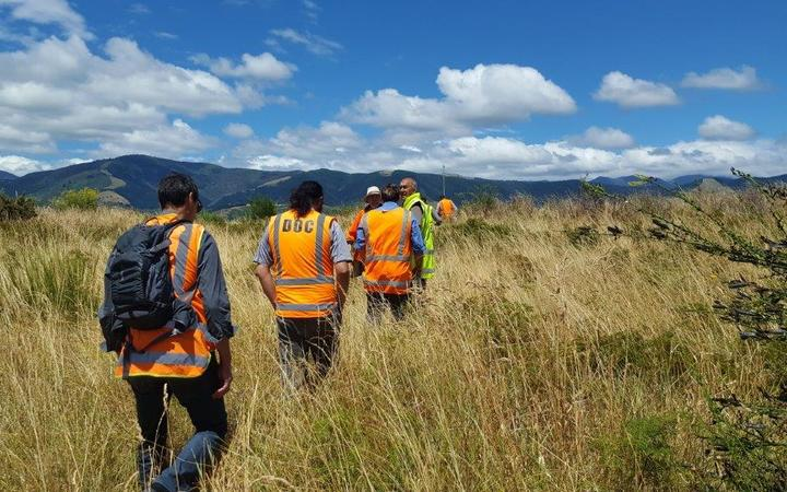 Iwi representatives on their way to the site of a human jawbone discovered in Nelson's Waimea Inlet.