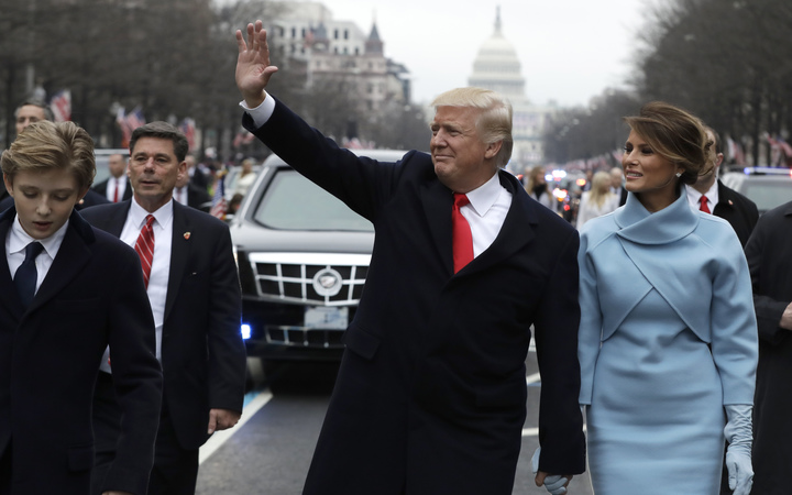 President Donald Trump and Melania Trump walking part of the way during the inaugural parade to the White House.