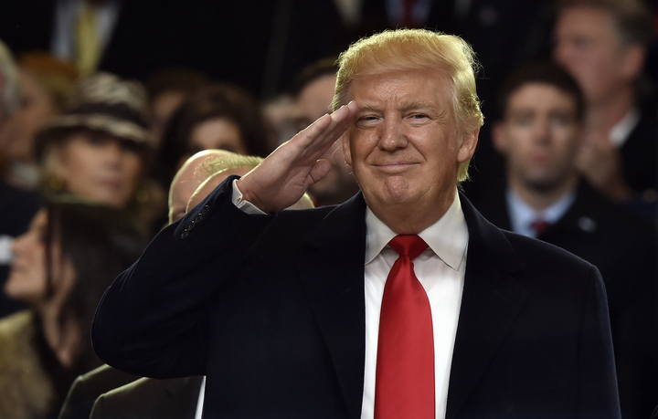 President Donald Trump salutes during the inauguration parade.