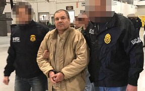 "This handout picture released by the Mexican Interior Ministry on January 19, 2017 shows Joaquin Guzman Loera aka ""El Chapo"" Guzman escorted in Ciudad Juarez by the Mexican police."