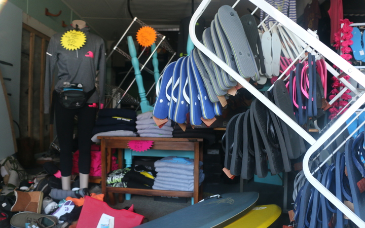 Kaikoura Surf has been shut since the 14 November earthquake. Business owner is Wayne Shanks. His wife Lisa Moffat's shop was next door. The whole building was yellow-stickered so both lost business.