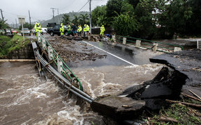 A road damaged after floods due to heavy rains on Tahiti.
