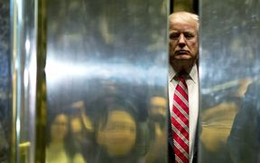 US President Donald Trump boards the elevator at Trump Tower.