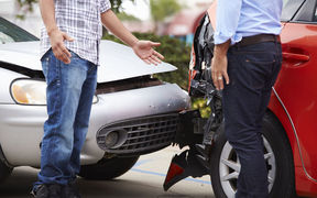 Drivers argue after a car crash (stock photo).