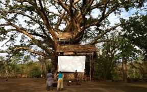 The cinema screen (2 sheets we'd brought attached to a giant banyan tree that somehow survived Cyclone Pam) constructed by the 'can do mob' of Yakel village, just weeks after the cyclone. Incredibly they insisted we come back to show the film as planned.  - Contact Films