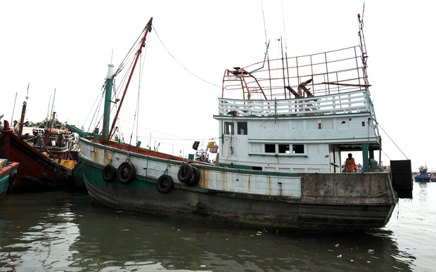 A wooden fishing boat used to transport nearly 600 mostly Rohingya migrants rests anchored at Lhokseumawe in Indonesia on 14 May.