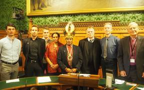 (L to R) Tim, Tom and Joel from Swim for West Papua, Maria Wenda, Benny Wenda, Rt Hon Andrew Smith MP, Peter Tatchell, Lord Harries.